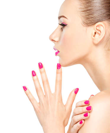 slicked: Profile face of a girl with pink nails. Fashion model posing on white background Stock Photo
