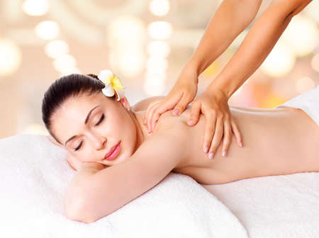 Woman having massage of body in the spa salon. Beauty treatment concept. photo