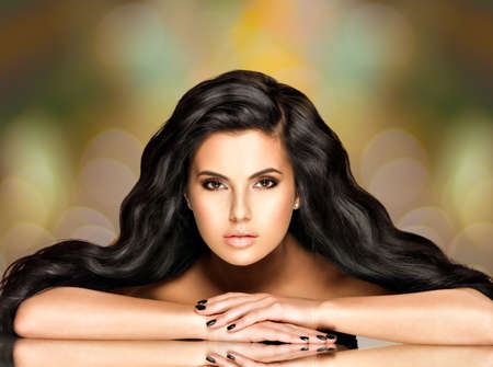 Portrait of a beautiful indian woman with long hairs over art creative background Stockfoto