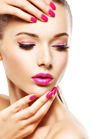 Beautiful woman face with pink makeup of eyes and nails. Glamour fashion model portrait
