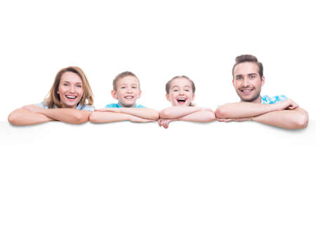 family isolated: Young family with a banner - isolated on a white background