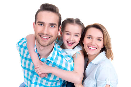 Caucasian happy young family with little girl and pretty white smiles - looking at camera photo