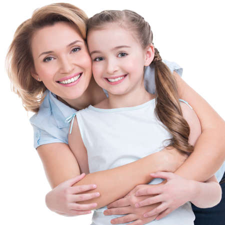 CLoseup portrait of happy  white mother and young daughter - isolated. Happy family people concept.
