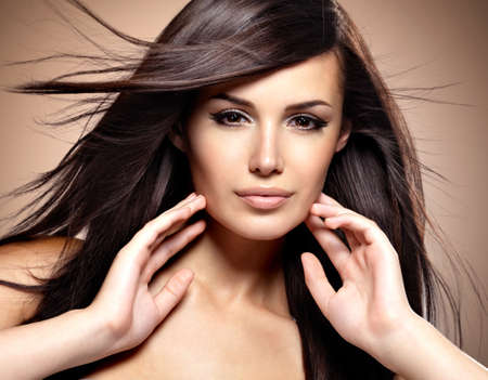 hair studio: Fashion model  with beauty long straight hair.  Creative studio image. Stock Photo
