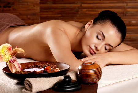 spa therapy: Recreation therapy for woman after massage in spa salon. Beauty treatment concept.