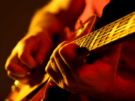 man playing guitar on a stage musical concert close-up view
