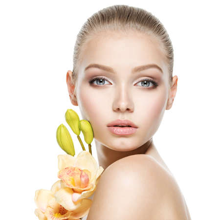 Beautiful face of the  healthy young woman with flowers  - isolated on white Stock Photo