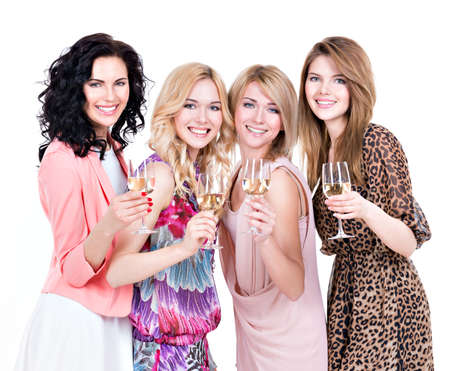 young group: Portrait of group young beautiful women have party and drinking wine - isolated on white. Stock Photo