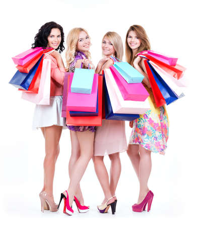 Full portrait of beautiful happy women with multicolor shopping bags isolated on a white background.