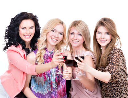 Portrait of young happy women having fun and drinking red wine - isolated on white. photo