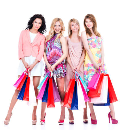 Full portrait of beautiful happy women with multicolor shopping bags isolated on a white background. photo