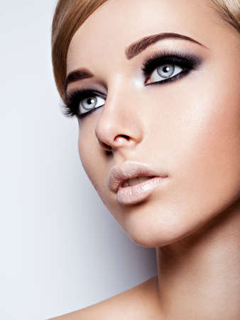 pretty eyes: Portrait of fashion model with  black makeup of eyes. Pretty attractive girl Stock Photo