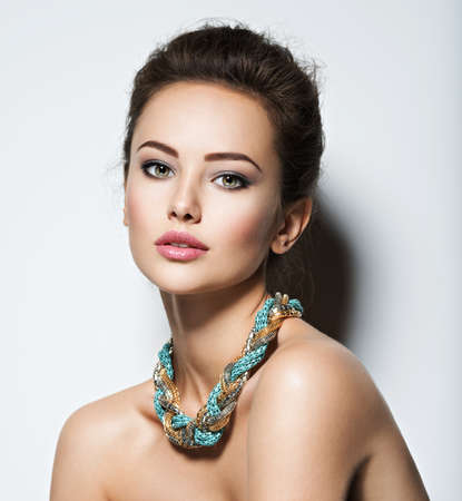 elegance fashion girls look sensuality young: beautiful woman with evening make-up jewelry and beauty fashion photo