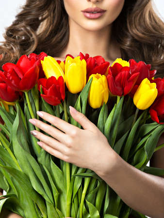 Woman with flowers. Half face. Stock Photo