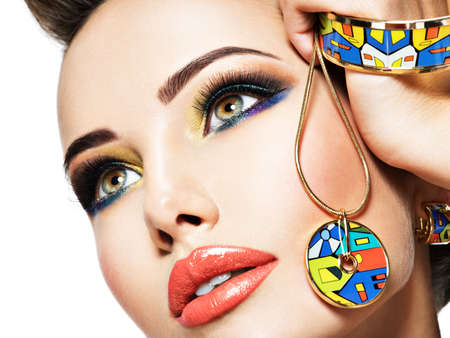 glamour makeup: Beautiful woman with creative bright colored make-up. Fashion girl with glamour jewelry Stock Photo