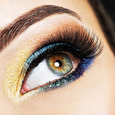 shine: Closeup female eye with beautiful fashion bright makeup.