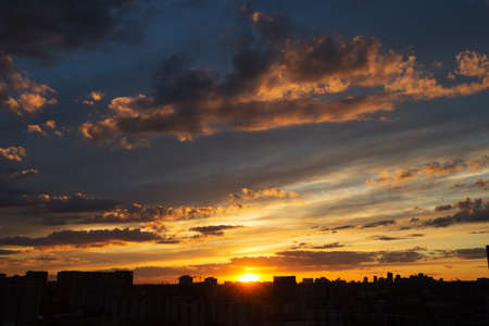 golden: Beautiful sunset over big city with amazing clouds