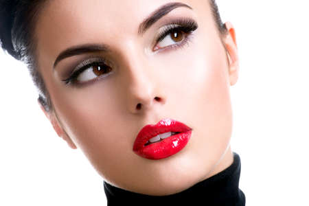black: Closeup portrait of a beautiful young fashion woman with glamour makeup posing at studio isolated on white.