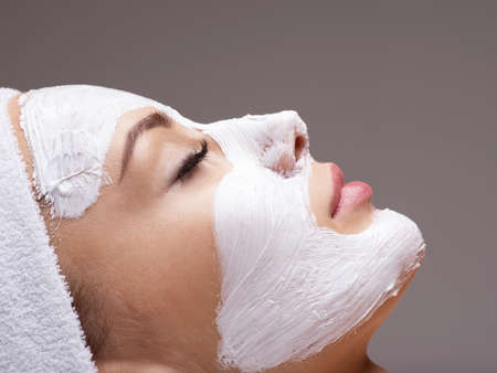 salon: Woman relaxing in spa salon with cosmetic mask on face. Beauty treatment