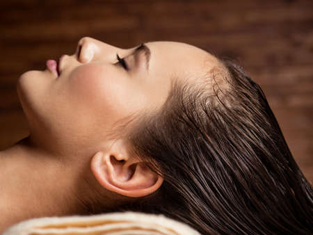 healthy body: young  woman receiving hair care procedure  in spa salon. Beauty treatment. Spa salon