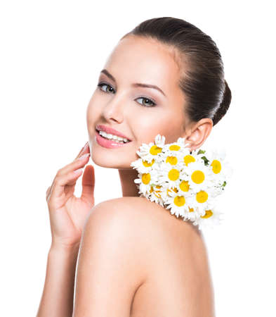 Smiling face of young beautiful woman holds a posy flowers - isolated on white background LANG_EVOIMAGES