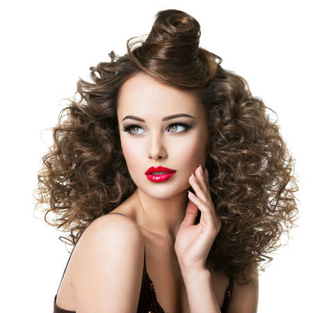 Beautiful woman with creative hairstyle. Attractive portrait of the fashion model with curly hair. LANG_EVOIMAGES