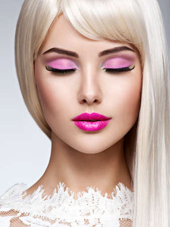Portrait of  a  Beautiful  woman with pink make-up and white straight  hairs. Face of a Fashion model with pink lipstick. LANG_EVOIMAGES