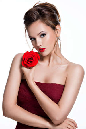 Beautiful woman with red rose in hands. Portrait of a pretty tender adult girl with creative hairstyle -   isolated on white