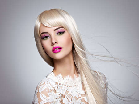 Portrait of  a  Beautiful  woman with long white straight  hairs and bright make-up.  Face of a Fashion model with pink lipstick. Pretty girl posing at studio. LANG_EVOIMAGES