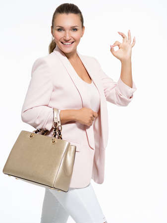 Portrait of aт young adult  happy woman with okay gesture Stock Photo