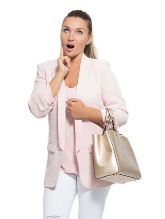Portrait of a wondering happy woman with handbag. Pretty adult woman with surprise emotions Stock Photo