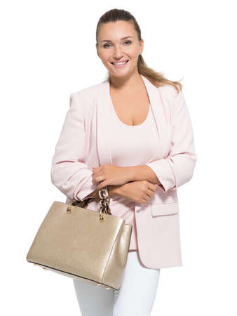 Portrait of an adult  smiling woman with handbag posing over white background LANG_EVOIMAGES