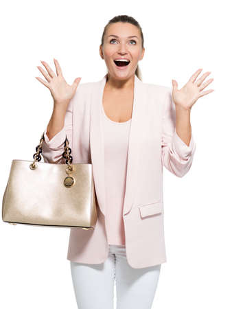 Portrait of a wondering happy woman with handbag over white background. Pretty adult woman with surprise emotions
