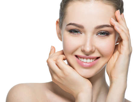 Young smiling woman with beautiful face, clean healthy skin - isolated on white. Skin care concept. Stock Photo