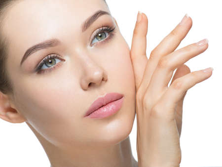 Young  woman with beautiful face and clean fresh skin. Skin care concept.  Beauty treatment.