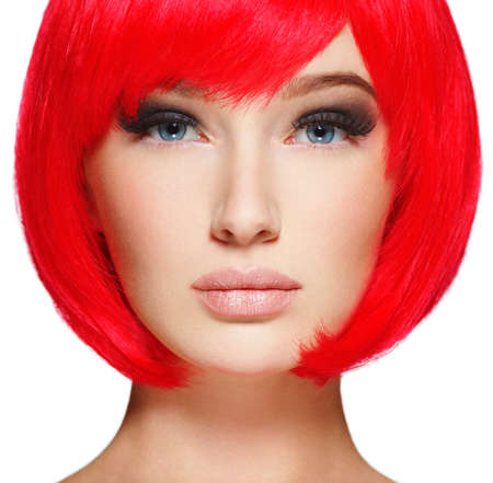 Gorgeous and stunning  woman with bob hairstyle red color.  Closeup face of a beautiful  girl with  brown eye makeup.
