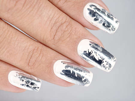 Stylish trendy female silver manicure. Macro shot.