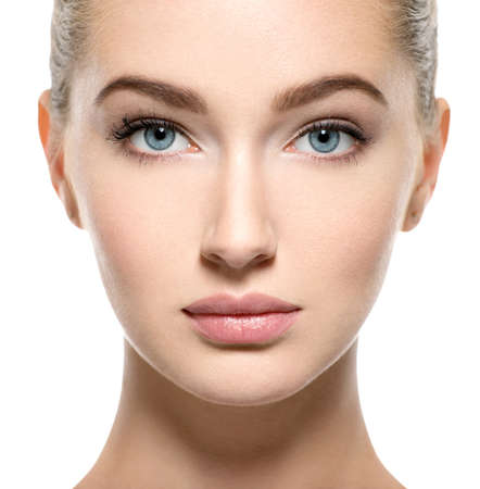 Young woman with beautiful face - isolated on white. Skin care concept.