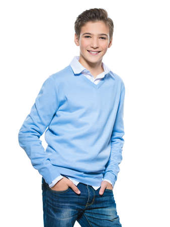 Photo of teenage young happy boy looking at camera.