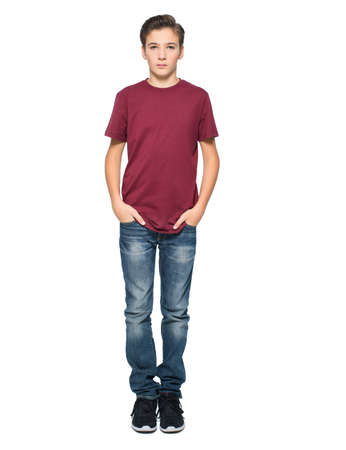 Photo of teenage young  boy posing at studio over white background