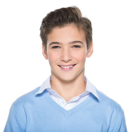 Photo of adorable teenage young happy boy looking at camera. Stock Photo