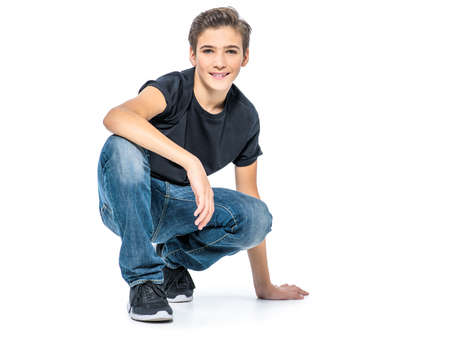 Photo of adorable teenage young happy boy looking at camera. Banque d'images