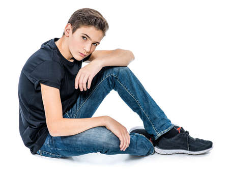 Photo of teenage handsome guy posing at studio. Fashion portrait of cute pretty teen boy 版權商用圖片 - 91077416
