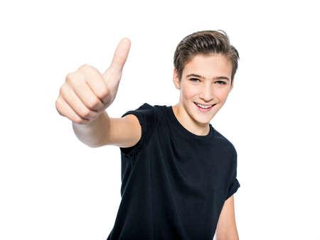 Photo of teenage boy with thumb up - looking at camera.