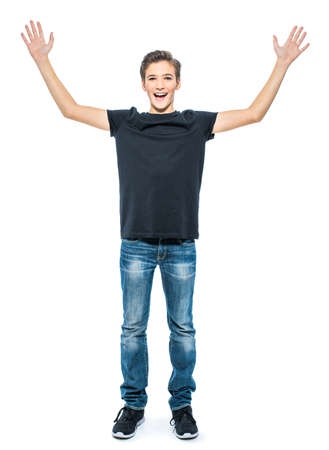 Photo of happy teenage boy  with hands up looking at camera.