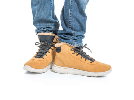 Part of male legs in winter boots - over white background Banque d'images