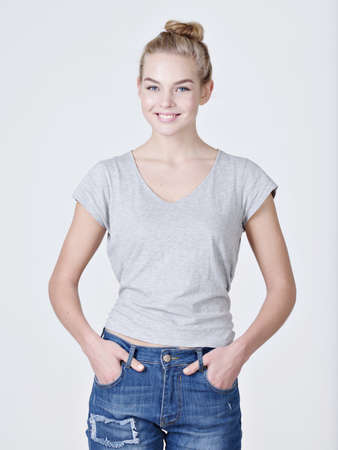 Beautiful young smiling caucasian woman posing  on white background 스톡 콘텐츠