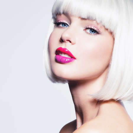 Fashion Stylish  Portrait with White Short Hair. Beautiful Girls Face with Haircut. Hairstyle. Fringe. Professional Makeup. Make-up.  Fashion portrait of woman with bob hairstyle. Vogue Style Woman.