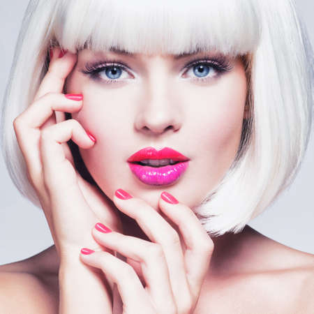 Fashion  Portrait of a  Beautiful Girls Face with professional Makeup. Vogue Style Woman. Bright red manicure. Vibrant lips. Multicolored.