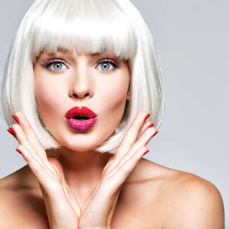 young surprised woman. Closeup face. Bright emotions. Fashion hairstyle. Isolated. White hair. Short haircut. Wondering.